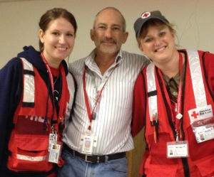 Helping others & making friends: Red Cross volunteers (l-r) Lizzie Kampf , Ed Newman (c) and Sue Buelow, in New York City for Superstorm Sandy.