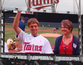 Two of our 2012 Heroes, Zachary Pierson (l) and Elizabeth Estepp, on the Target Field Jumbotron during a game day recognition event last spring. Photo credit: Gene Sung/American Red Cross.