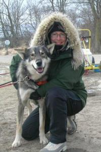 Linda Newman and Arrow, one of her sled dogs. Photo courtesy of Linda (and Arrow).