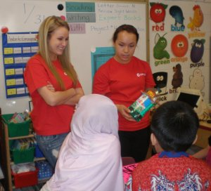 Katie and Nicole from the Como Park Future Educators Club talk with kids about safe substances versus poisons in the home. (Photo credit: Lisa Joyslin/American Red Cross)
