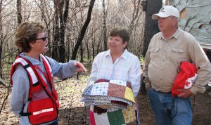 Red Cross disaster relief volunteer Diane Dunder talks with Joan and John Belch.
