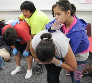 Red Lake, MN, fifth-graders learn skills to save a choking victim during an American Red Cross Babysitter's Training class on June 20, 2013.