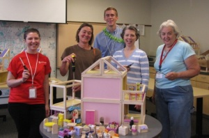 Armed with screwdrivers and one page of instructions, Red Cross volunteers build dollhouses for fire safety instruction, July 31, 2013.