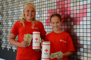During their county fair, Brianna Brolin, age 14, and Aliyah Robran, age 9, raised money for American Red Cross disaster relief.