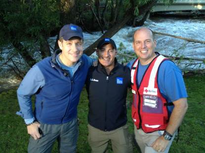 Jim Rettew (r), and Weather Channel journalists, including Jim Cantore (c), during the flood relief response in Boulder, Colorado, September, 2013. Submitted photo.