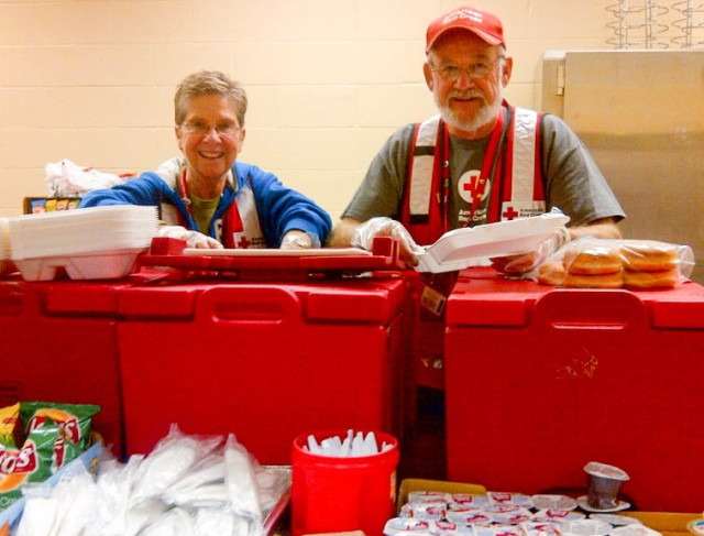 Gifts that give support the Red Cross in many ways, such as sending trained volunteers, like Karen and Rick Campion from Minnesota, to help people affected by disasters. Here, there were in Illinois responding to the relief operation after the tornado storms that hit November 17, 2013.