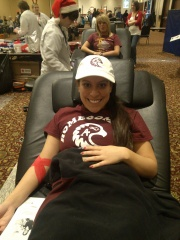 Lia Capaldini, Augsburg College senior, donating blood for the first time at the 12 Hours of Giving on Decbember 23, 2013.