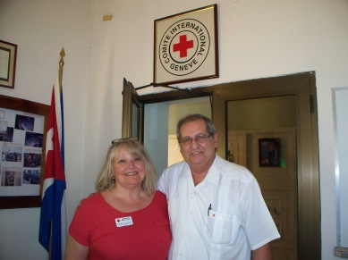 Red Cross volunteer Kathryn Schmidt (l) and Dr. Luis Foyo Ceballos, Director of the Cuban Red Cross (r) in Havana, April 2014. Photo provided courtesy of the author.