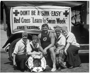 Commodore Wilbert E. Longfellow, founder of the Red Cross Water Safety Program and members of the YWCA Life Saving Corps. (Source: Red Cross photo archive.)