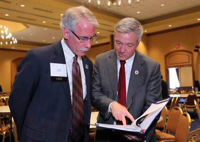 Local Red Cross CEOs Geoff Kaufmann and Phil Hansen. Photo credit: Andy King