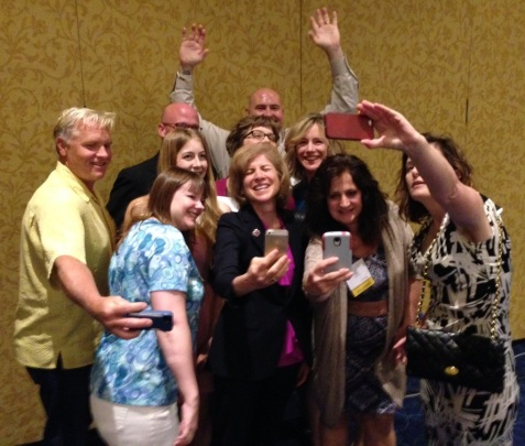 "Red Cross President & CEO Gail McGovern takes a group ""selfie"" with the Social Advocates. Photo credit: Carrie Carlson-Guest"