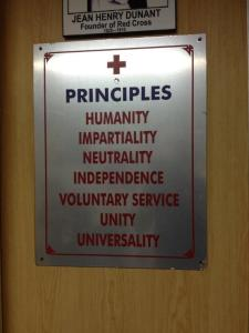 The global Red Cross Red Crescent 7 fundamental principles posted at the Indian Red Cross Society, Karnataka Branch, 2014. Photo credit: Craig Yolitz.