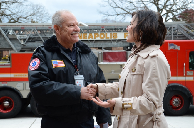 Minneapolis, Minn., Mayor Betsy Hodges thanks American Red Cross Emergency Medical Response (EMR) Instructor Steven Brown for successful EMR training of the first Emergency Medical Technician (EMT) youth group at Roosevelt High School in Minneapolis, on Tuesday, October 28, 2014. Photo credit: Lynette Nyman/American Red Cross