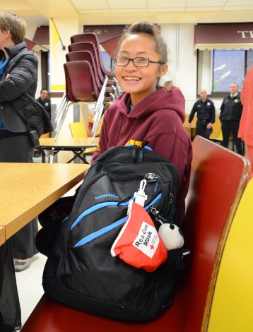 Roosevelt High School student Kalia Vang, 17, is one of 11 youth who successfully complete the school's first American Red Cross Emergency Medical Response (EMR) course. She received her course certificate from the Red Cross on Tuesday, October 28, 2014 in Minneapolis. Photo credit: Lynette Nyman/American Red Cross