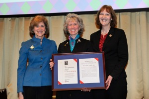 Janice Springer (c) receives the Ann Magnussen Award from Gail McGovern (l) and Linda MacIntyre (r) during the American Red Cross National Awards and Recognition Dinner on February 18, 2015, in Washington D.C. Photo by Jason Colston/American Red Cross