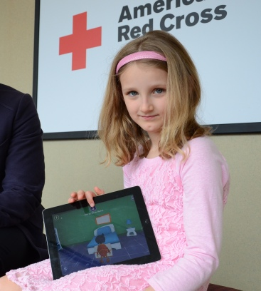 In two days, Aryn Gill, 7, graduated from rookie to member playing the American Red Cross Monster Guard mobile app that prepares kids for real-life emergencies. Photo credit: Lynette Nyman/American Red Cross