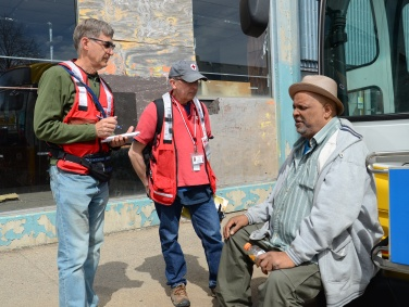 W. Broadway Fire victim Cliff Garrett shares his story with Red Cross volunteers in North Minneapolis on April 15, 2015. Photo credit: Lynette Nyman/American Red Cross