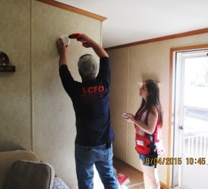 Smoke alarm installation during Home Fire Preparedness Campaign, Lake City, MN, April 18, 2015
