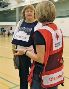 Volunteer evacuee Maggie Friend talks to a Red Cross volunteer about her mental health.
