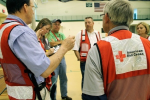 Red Cross volunteers recap the event and make suggestions about what can be improved next time.