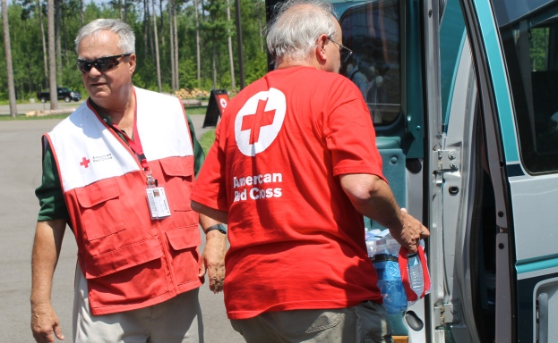The Red Cross provided water, ice and relief supplies at the relief station. Like many Red Cross volunteers, Gary Larson and Ken Vertin spent the day loading cases of water into vehicles.