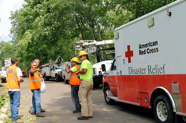To date, the Red Cross has distributed thousands of bottles of water and hundreds of pounds of ice to Brainerd Lakes area residents and work crews cleaning up in hot and humid conditions following the windstorm. July 15, 2015. Photo credit: Vivian Engen/American Red Cross.