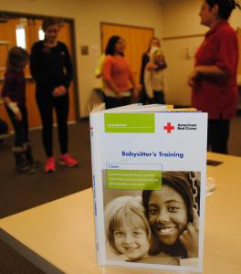 Learning materials are provided by the American Red Cross to aid in the education of all attendees (Handbook, Reference Guide, Student Kit). Photo credit Krista Weiler/American Red Cross, Minneapolis, Minn., Feb. 2015.