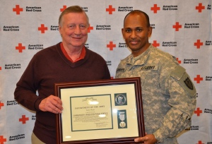 Terry Sluss of Baxter, MN, lead Red Cross volunteer for this summer's Vigilent Guard Exercise, was presented the Minnesota National Guard Commander's Award for Public Service by Major Joe Sanganoo. Sluss is also Minnesota Region Deputy Volunteer Lead for Disaster Services.