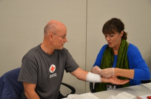 Terrance Schoonover (left) of Rochester and Terri O'Grady of Edina practiced their first aid skills during a First Aid and CPR class at the Institute.