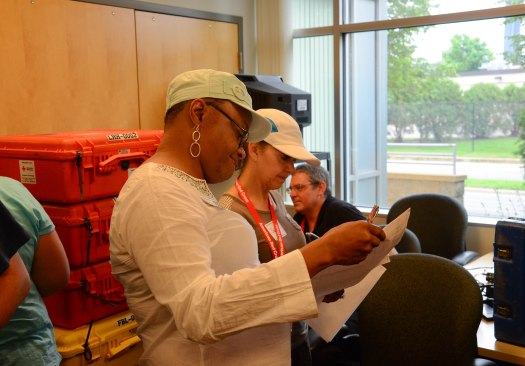 American Red Cross trainees, Debbie Johnson and Phyllis Wiggins, checking supplies for disaster services technology operations during a practice run