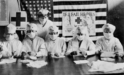 Red Cross volunteers make influenza face masks during the influenza epidemic in 1918. Photo: American Red Cross Photo Library