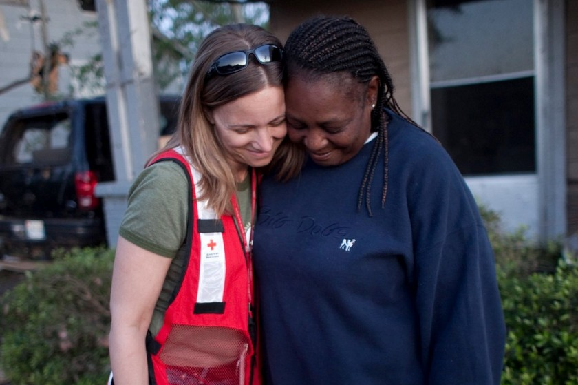 In 2011, following a devastating tornado in Tuscaloosa, Alabama, Georgette Evans, who walked miles to find medical services and safe shelter following the devastating tornado, visits with to Lynette Nyman in Alberta City neighborhood. Photo credit: Dennis Drenner/American Red Cross
