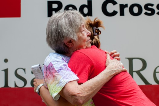 """""""I want a hug,"""" said Fonda Buckley, a resident just beginning to recover from the historic flooding in southern Louisiana, who stopped to talk with Red Cross relief worker Lynette Nyman in Denham Springs, Louisiana, August 18, 2016. Photo credit: Marko Kokic/American Red Cross"""