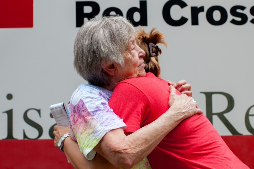 """I want a hug,"" said Fonda Buckley, a resident just beginning to recover from the historic flooding in southern Louisiana, who stopped to talk with Red Cross relief worker Lynette Nyman in Denham Springs, Louisiana, August 18, 2016. Photo credit: Marko Kokic/American Red Cross"