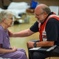 For one woman seeking refuge from Hurricane Dorian, a Red Cross vest evokes memories of Minnesota childhood