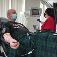 Stuart's Back - Rolling Up a Sleeve to Help Patients in Need
